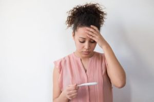 img-blog-Black woman desperate after reading pregnancy test result