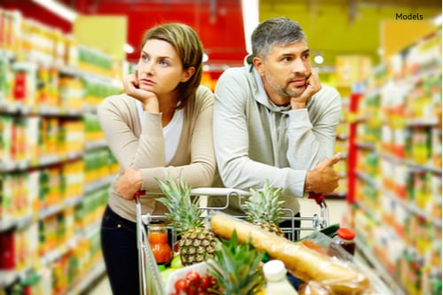 Image of young couple with cart in supermarket-img-blog