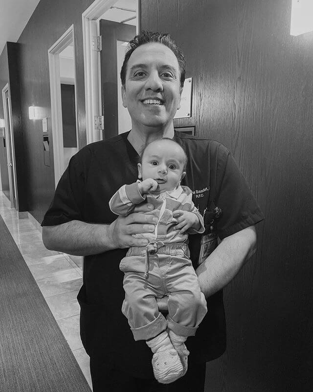 Doctor Saadat with a Baby