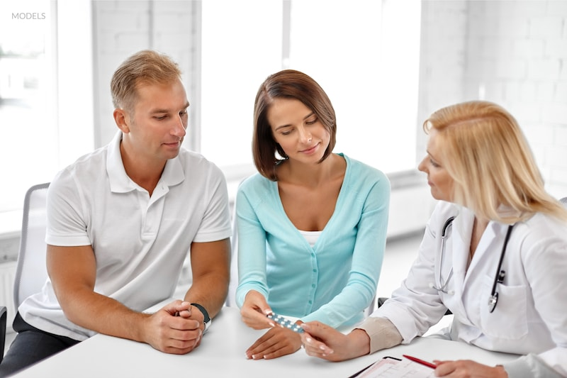 A couple visiting a fertility clinic to discuss testing options.